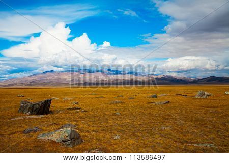 Multicolored Steppe Landscape With Large Stones