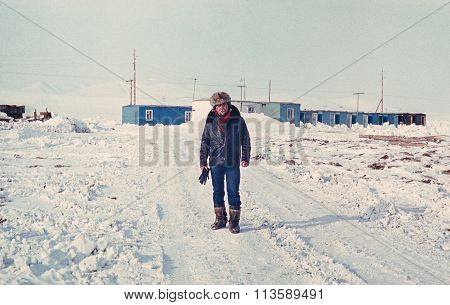 Soviet gold prospector on an only street of small gold-prospectors' settlement in tundra