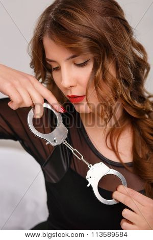 Sexual woman posing with handcuffs.