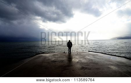 Unrecognizable man on a  pier . Lake Ohrid Macedonia