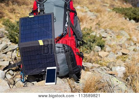 The solar panel attached to the tent.