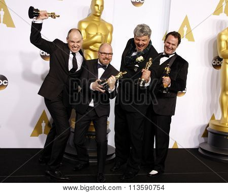 Andrew Lockley, Ian Hunter, Scott R. Fisher and Paul Franklin at the 87th Annual Academy Awards - Press Room held at the Loews Hollywood Hotel in Los Angeles, USA on February 22, 2015.
