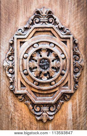 Detail Of An Ancient Wooden Door Carved.
