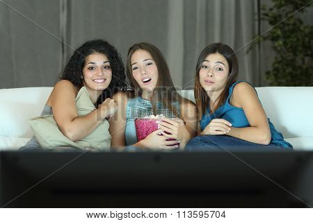 Three Friends Watching Romantic Movie On Tv