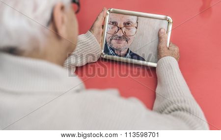 Old Woman Looking At Her Husband Photo