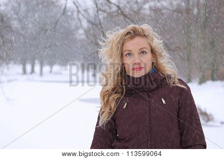 woman in heavy snowfall