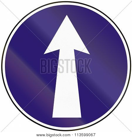 Road Sign Used In Slovakia - Mandatory Direction Straight