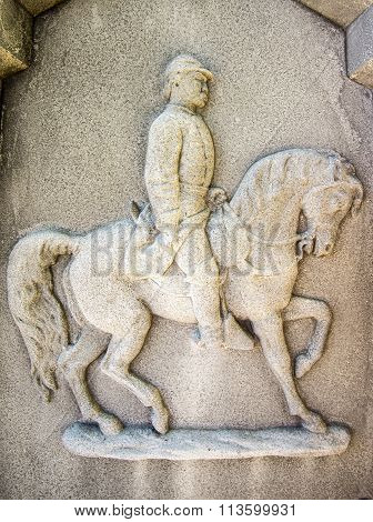 solider and horse on a tombstone