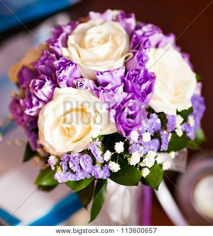 Bride's bouquet with white roses and purple flowers
