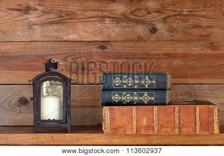 books and a lantern on a shelf