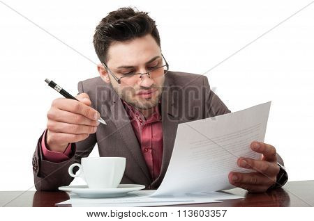 Young Business Man Checking Company Documents.