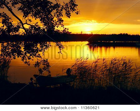 Lake At Sunset With Boat