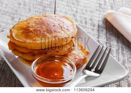 pancakes fritters carrot with maple syrup breakfast