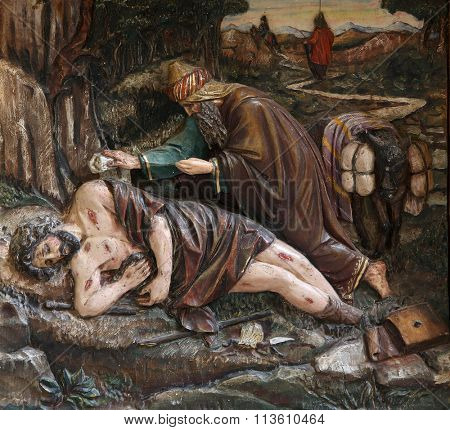 STITAR, CROATIA - NOVEMBER 24: Relief of merciful Samaritan, main altar in the church of Saint Matthew in Stitar, Croatia on November 24, 2015
