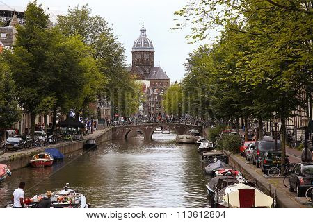 Amsterdam, The Netherlands - August 16, 2015: View On Saint Nicholas Church Or St Nicolaas Kerk Towe