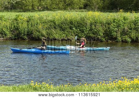 Two friends canoeing together