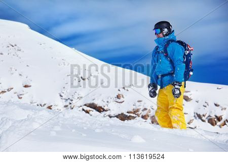 Tourist in snowboard outfit at the winter resort