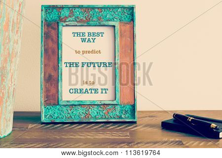 Motivational Quote Written On Vintage Photo Frame The Best Way To Predict The Future Is To Create It