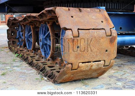 The old rusty track of the crawler tractor