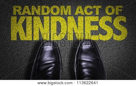 Top View of Business Shoes on the floor with the text: Random Act of Kindness