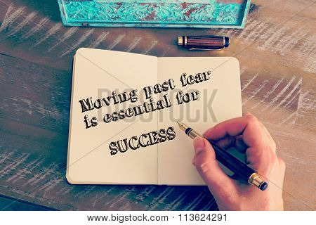 Motivational Message Moving Past Fear Is Essential To Success Written On Notebook