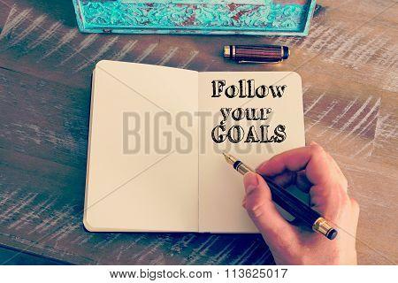 Motivational Message Follow Your Goals Written On Notebook