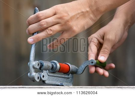 Hands Reloading Cartridge By Shotgun Shell Reloader, Closeup