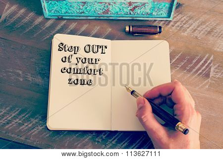 Motivational Message Step Out Of Your Comfort Zone Written On Notebook