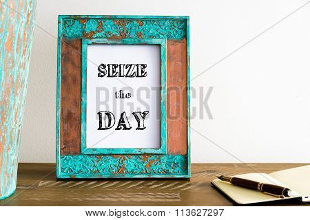 Vintage Photo Frame On Wooden Table With Text Seize The Day