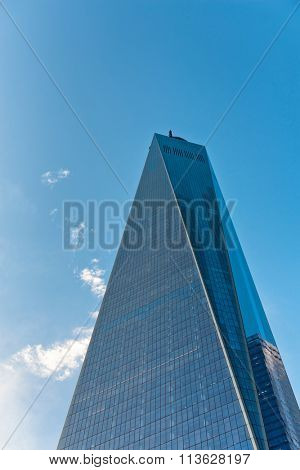 NEW YORK - SEPTEMBER 06: Exterior glass facade of One World Trade Center, Manhattan, New York against a clear sunny blue sky looking up from directly below. September 06, 2015 in New York.