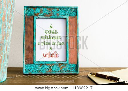 Vintage Photo Frame On Wooden Table With Text A Goal Without A Plan Is Just A Wish
