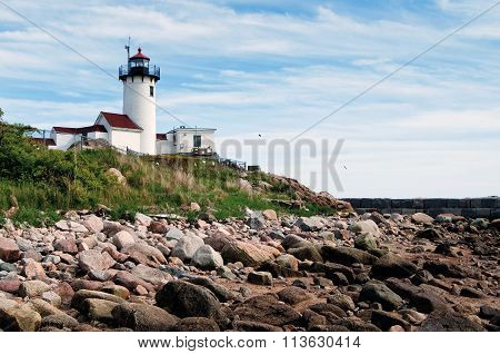 Gloucester Lighthouse Over Rocky Shore