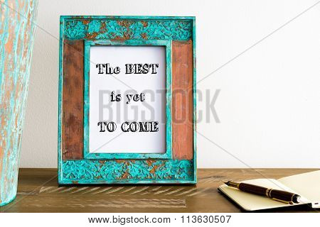 Vintage Photo Frame On Wooden Table With Text The Best Is Yet To Come