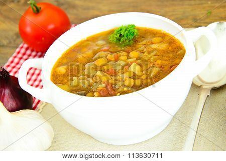 Lentil soup with eggplant, tomatoes and onions
