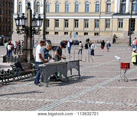 Street Musicians Are Playing On The Xylophone On The Senate Square In Helsinki