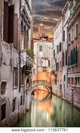Narrow Canal In Venice In The Evening