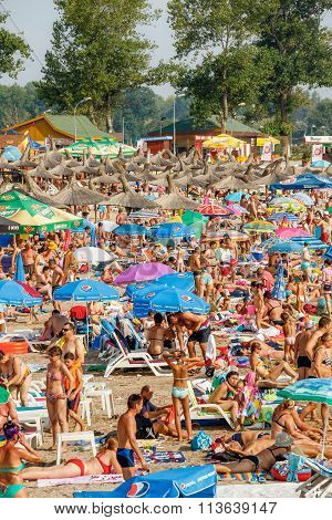 Neptun Jupiter, Romania - Jully 31, 2015 Unidentified People Enjoying The Sun On A Crowded Beach At