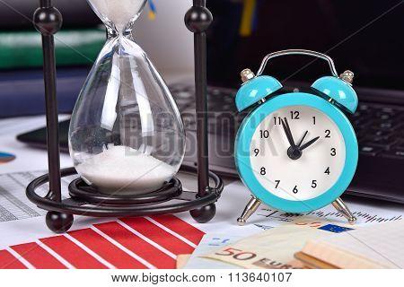 Sandglass And Alarm Clock