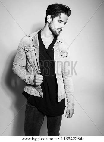 handsome young and fit man posing in casual clothes