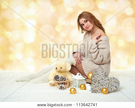 beautiful young girl with teddy bear toy on yellow bokeh  background - romantic holiday concept
