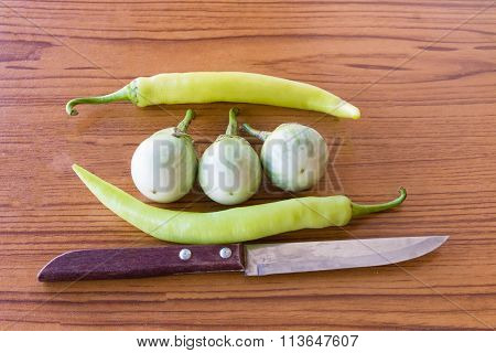 CutlassEggplant pepper on the table.Kitchen a knives