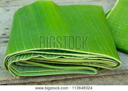 Banana leaf placed on a wooden table