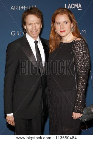 Jerry Bruckheimer and Alexandra Balahoutis at the LACMA 2013 Art + Film Gala Honoring Martin Scorsese And David Hockney Presented By Gucci held at the LACMA in Los Angeles, USA on November 2, 2013.