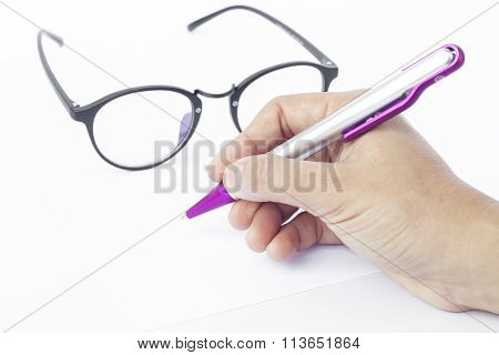 Hands Writing Recipient Address On White Envelope