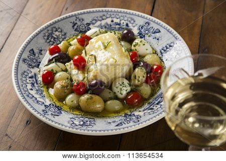 A Typical Portuguese Dish With Codfish Called Bacalhau Do Porto In A Original Portuguese Plate.
