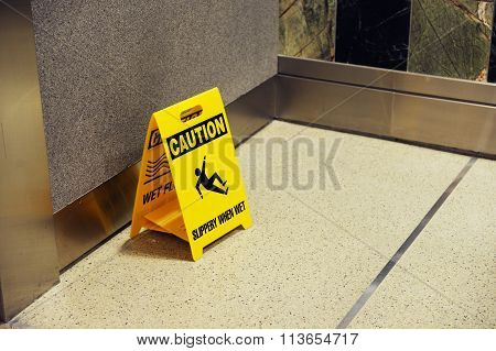 caution for slip when wet sign in office hall way