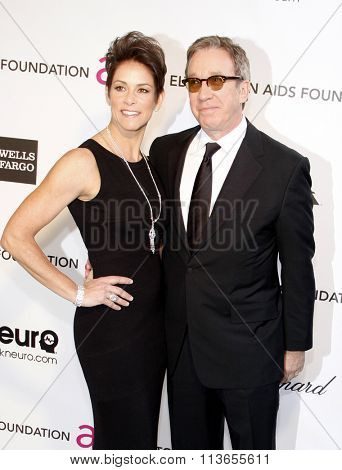 Tim Allen and Jane Hajduk at the 21st Annual Elton John AIDS Foundation Academy Awards Viewing Party held at the West Hollywood Park in Los Angeles, USA on February 24, 2013.