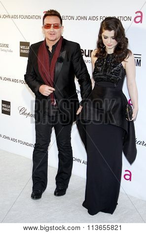 Bono and Eve Hewson at the 21st Annual Elton John AIDS Foundation Academy Awards Viewing Party held at the West Hollywood Park in Los Angeles, USA on February 24, 2013.