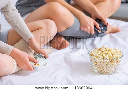 Two girls are playing videogames.