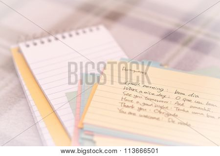 Portuguese; Learning New Language Writing Greetings On The Notebook